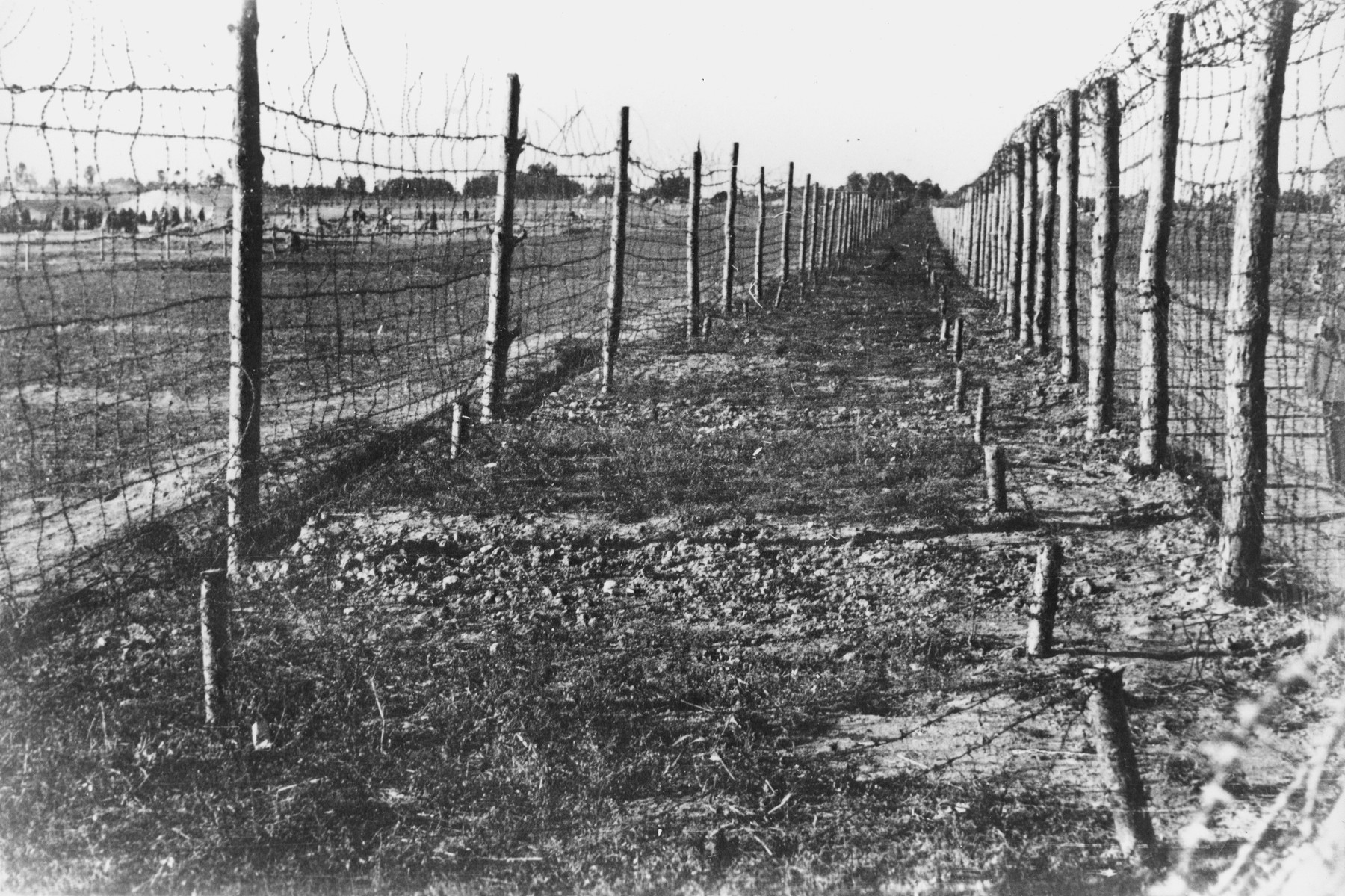 Soviet POWs are visible to the left of the double enclosure of the Soviet POW camp in Chelm,