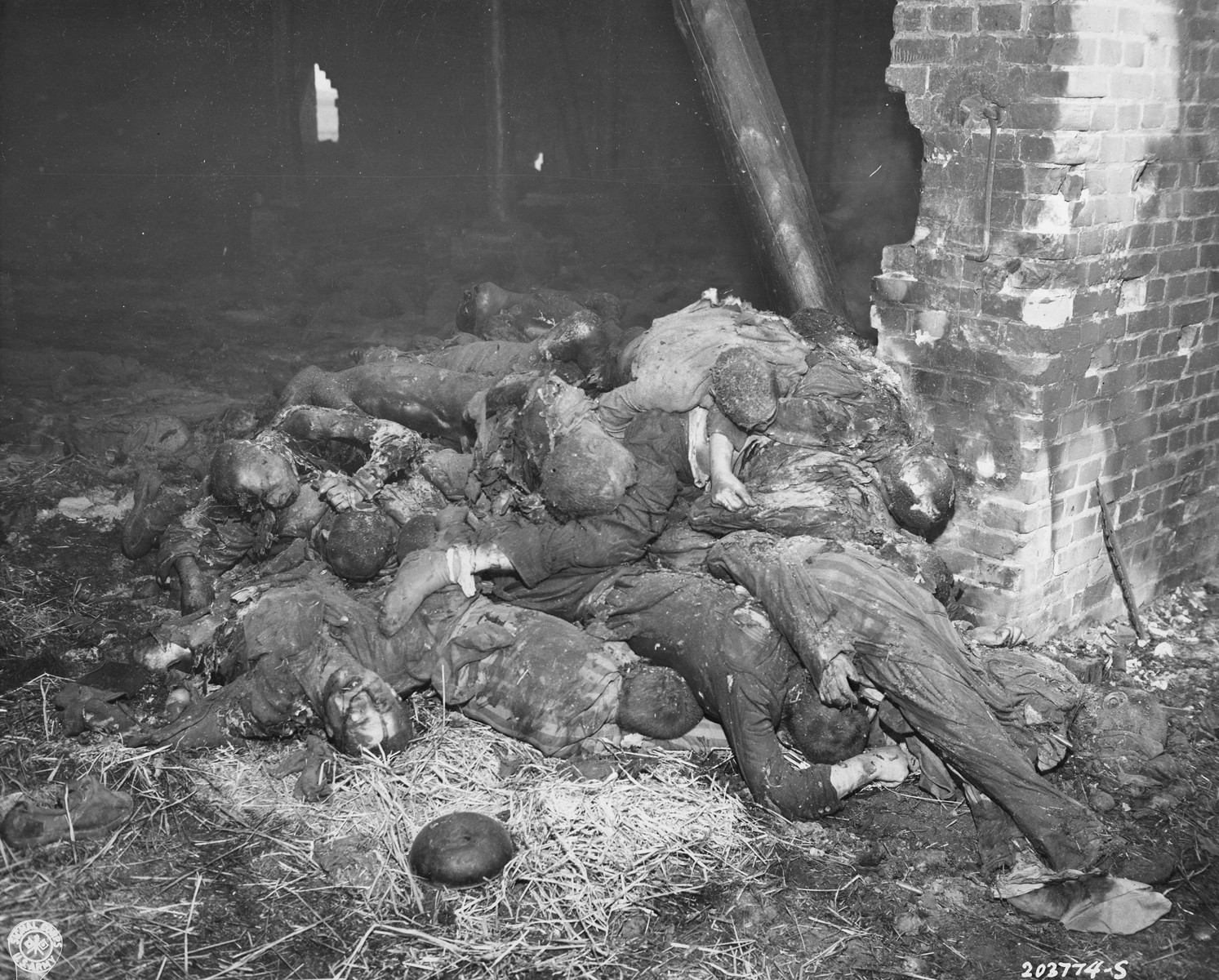 The charred corpses of prisoners burned alive by the SS in a barn outside of Gardelegen.