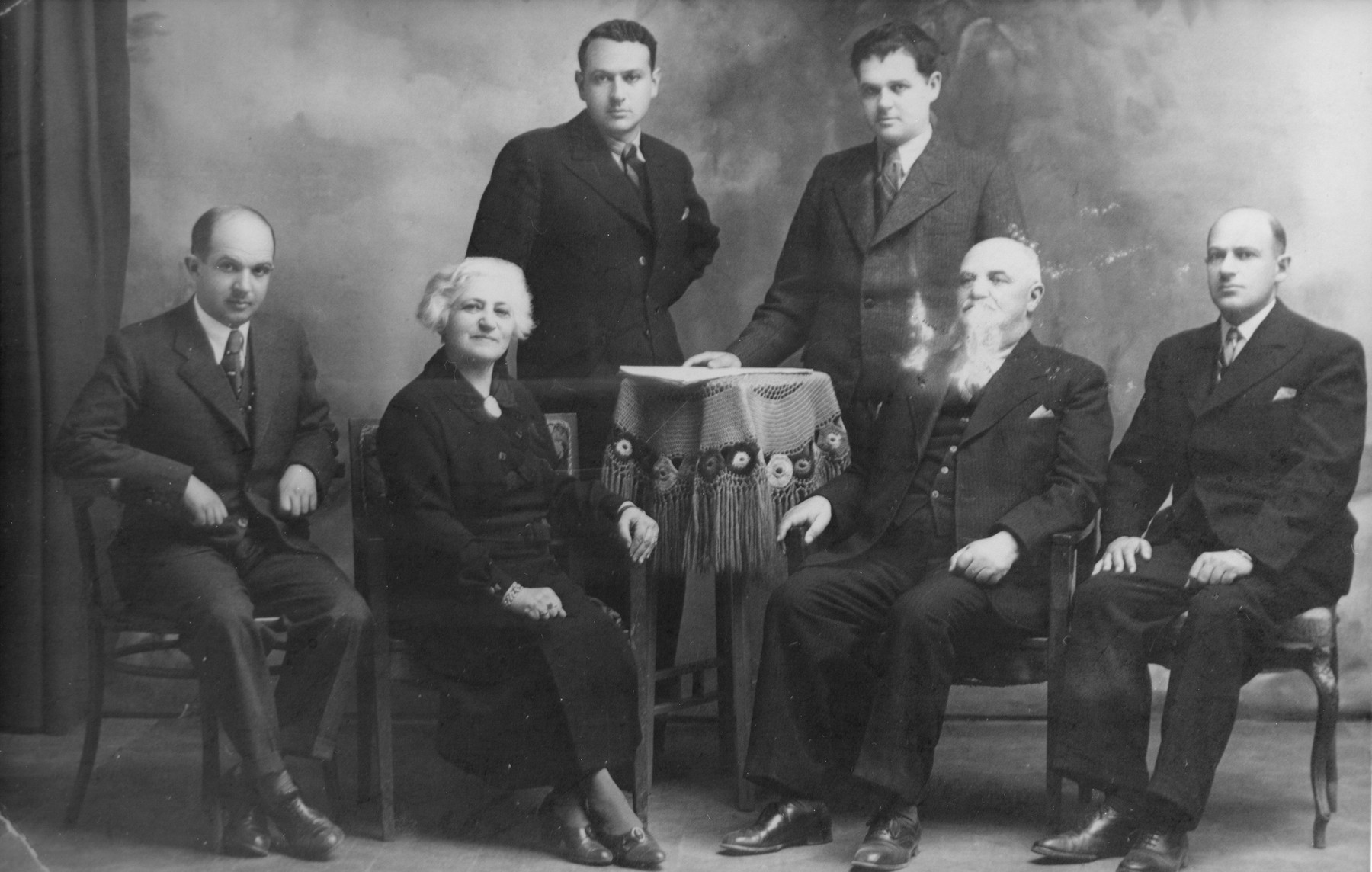 Portrait of the Preiss family in Kotoriba, Yugoslavia. Pictured are Samu and Helen Rosenfeld Preiss and their four grown sons: Pista, Jani, Laci, and Bubi.  Samu and Helen were the donor's uncle and aunt.