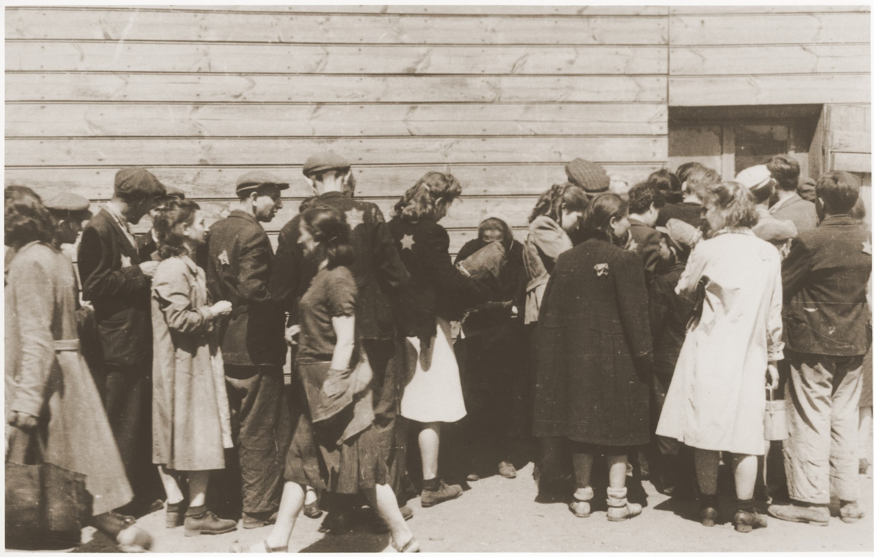 Jews wait in line [at a soup kitchen] in the Lodz ghetto.