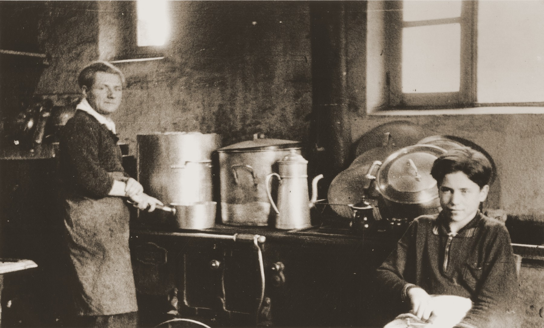 Heinz Stephan Lewy works in the kitchen of the Château de Chabannes OSE (Oeuvre de secours aux Enfants) children's home.