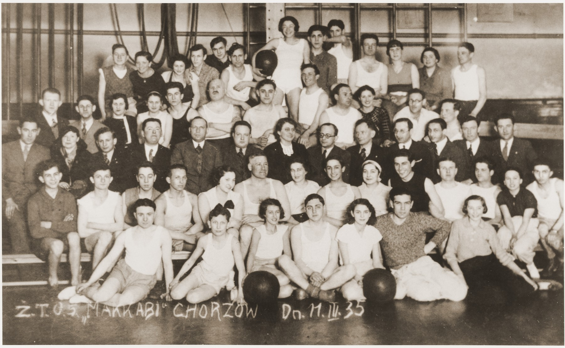 Group portrait of members of a Maccabi sports club in Chorzow, Poland.    Among those pictured is Henryk Wiener (first row, second from the left).