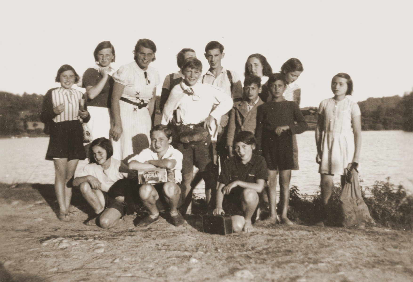 Group portrait of Jewish youth from the OSE children's home at Chateau du Chaumont, on an outing.    Among those pictured is Walter Karliner (back row, second from the left), Kurt Siegfried Hirschhorn (center, fourth from right) and Joseph Polzer, center, with  a pair of shoes hanging around his waist.  Kurt Hirschhorn was deported in August 1942.