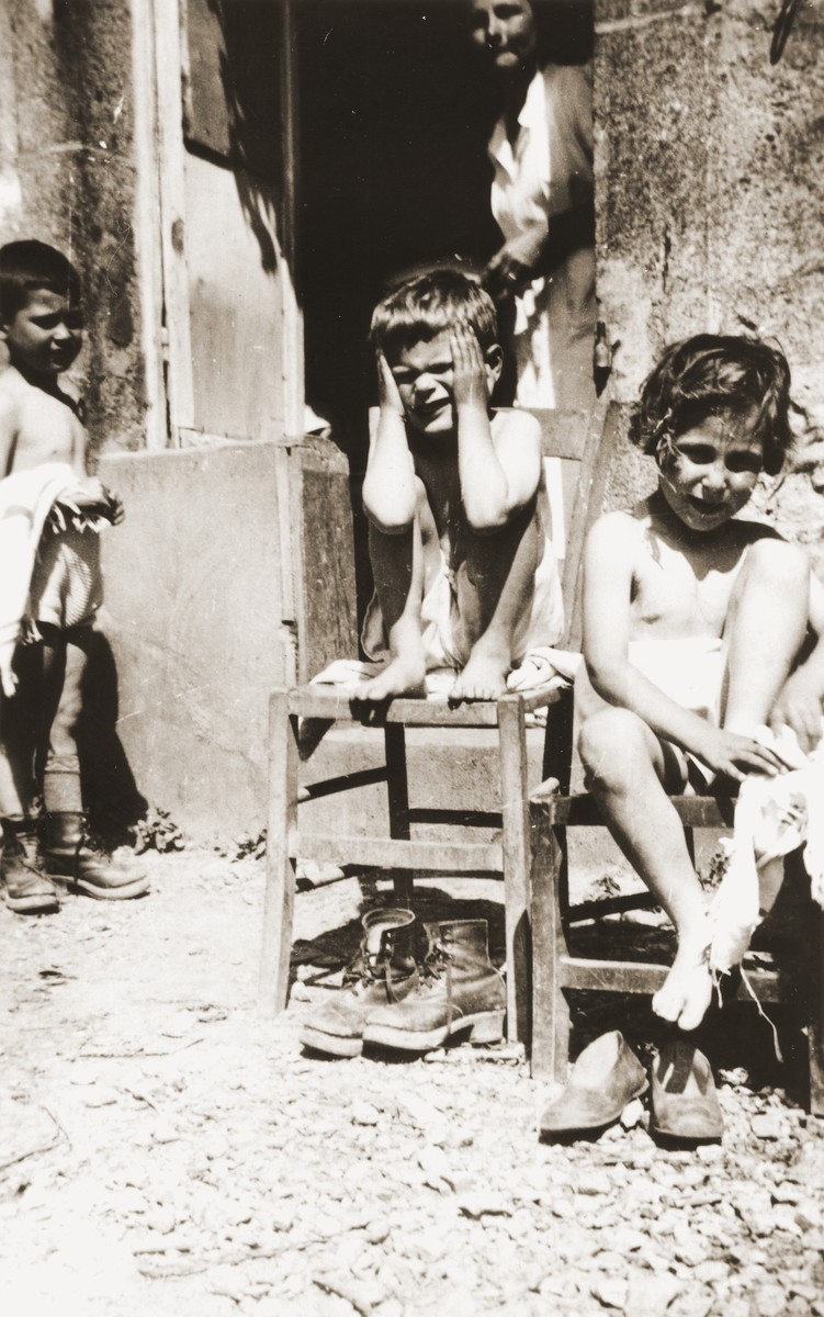 Jewish refugee children from the Château de Chabannes OSE (Oeuvre de secours aux Enfants) children's home, dry themselves after their weekly shower.