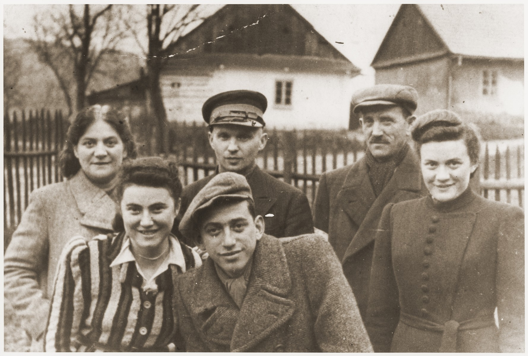 Group portrait of young Jewish men and women in the Wisnicz Nowy ghetto.