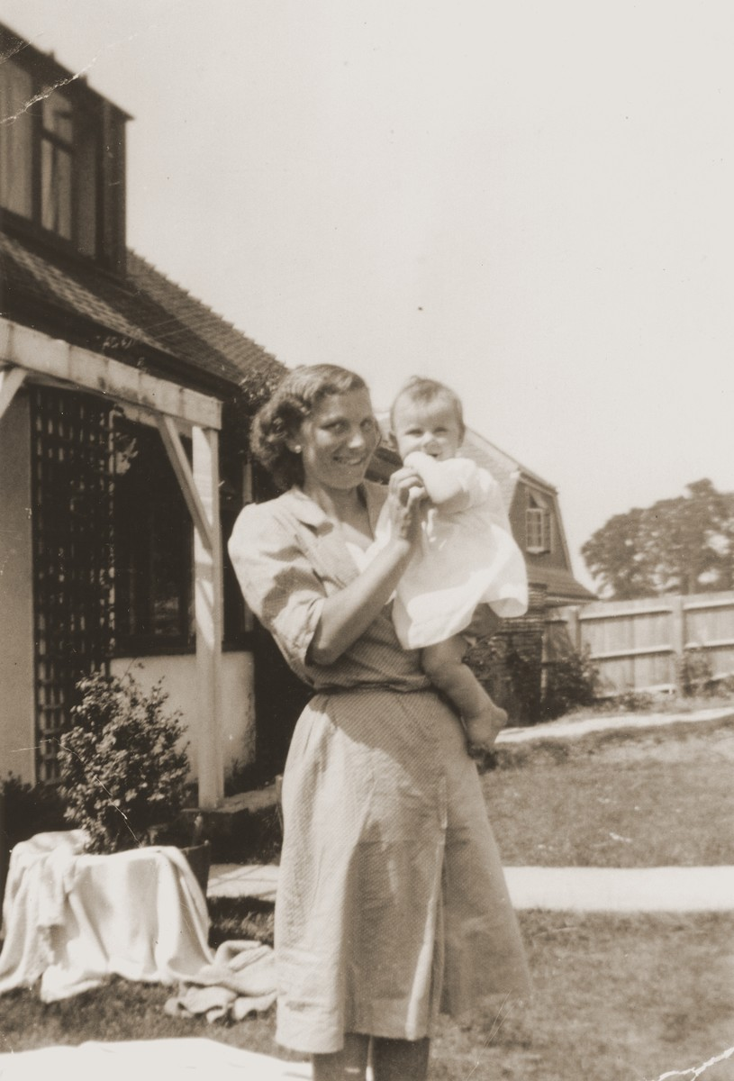 An Austrian Jewish refugee takes care of the child of a British officer at his home in England.  Pictured is Kathe Spiegler, the half-sister of Eugen Spitzer.
