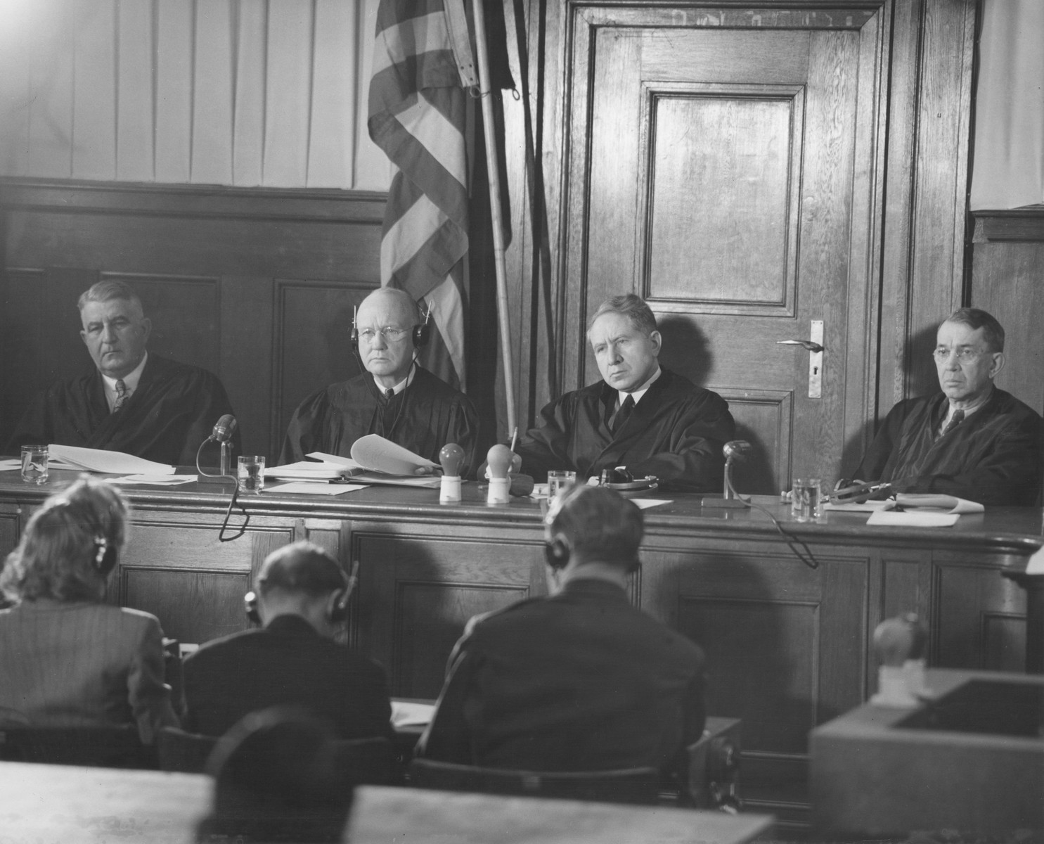 The judges of Military Tribunal II at a session of the Milch Trial.    Pictured from left to right are F. Donald Phillips, Robert M. Toms, Michael A. Musmanno, and John J. Speight.