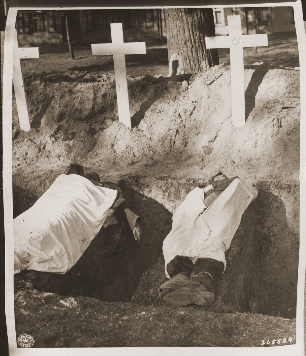 The corpse of a prisoner who died in the concentration camp at Woebbelin lies next to an open grave.    The townspeople were forced by U.S. troops to bury the corpses on the palace grounds of the Archduke of Mecklenburg.