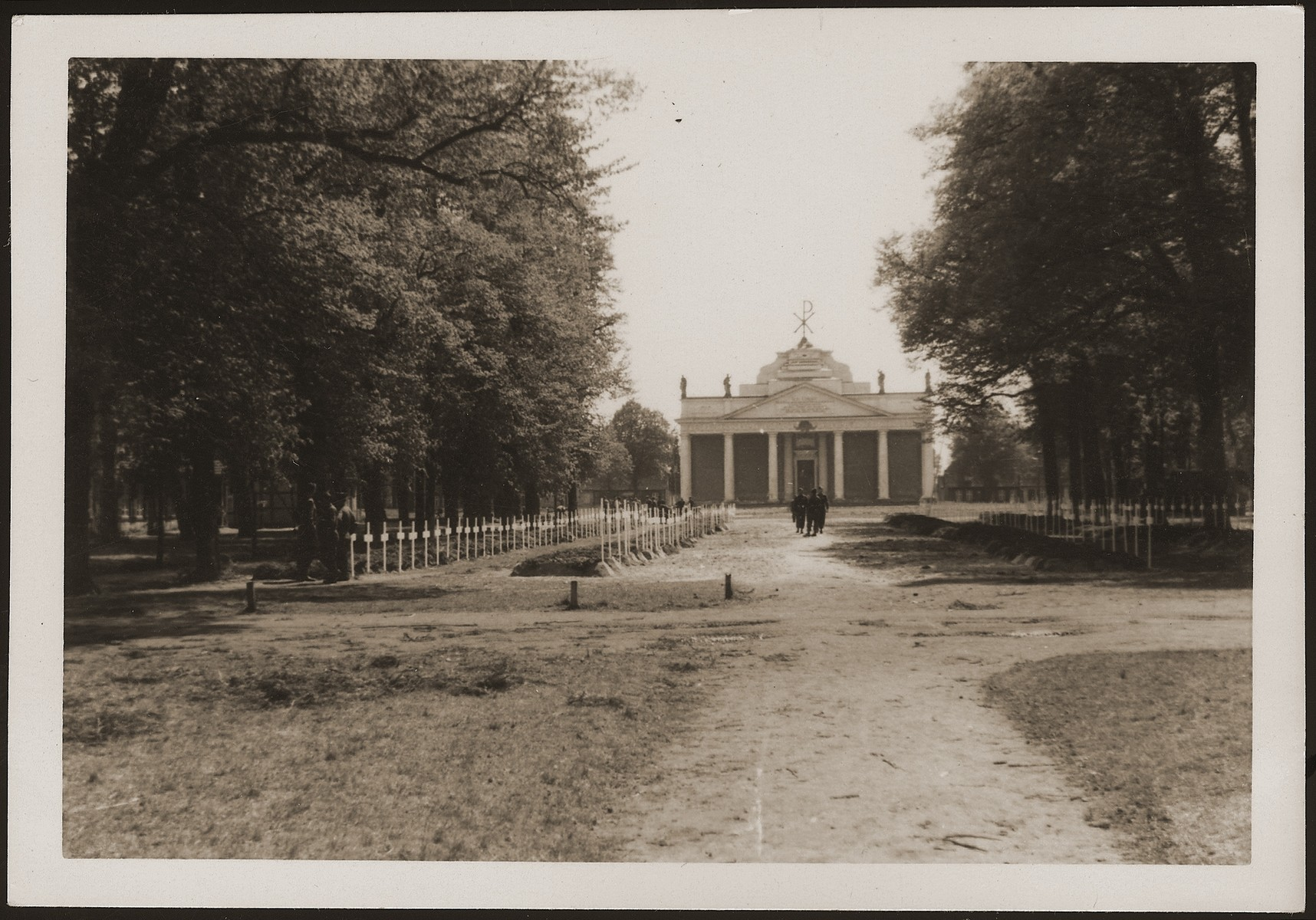 A view of the burial ground in Ludwigslust on the palace grounds of the Archduke of Mecklenburg, where the townspeople were forced by U.S. troops to bury the corpses of prisoners killed in the Woebbelin concentration camp .