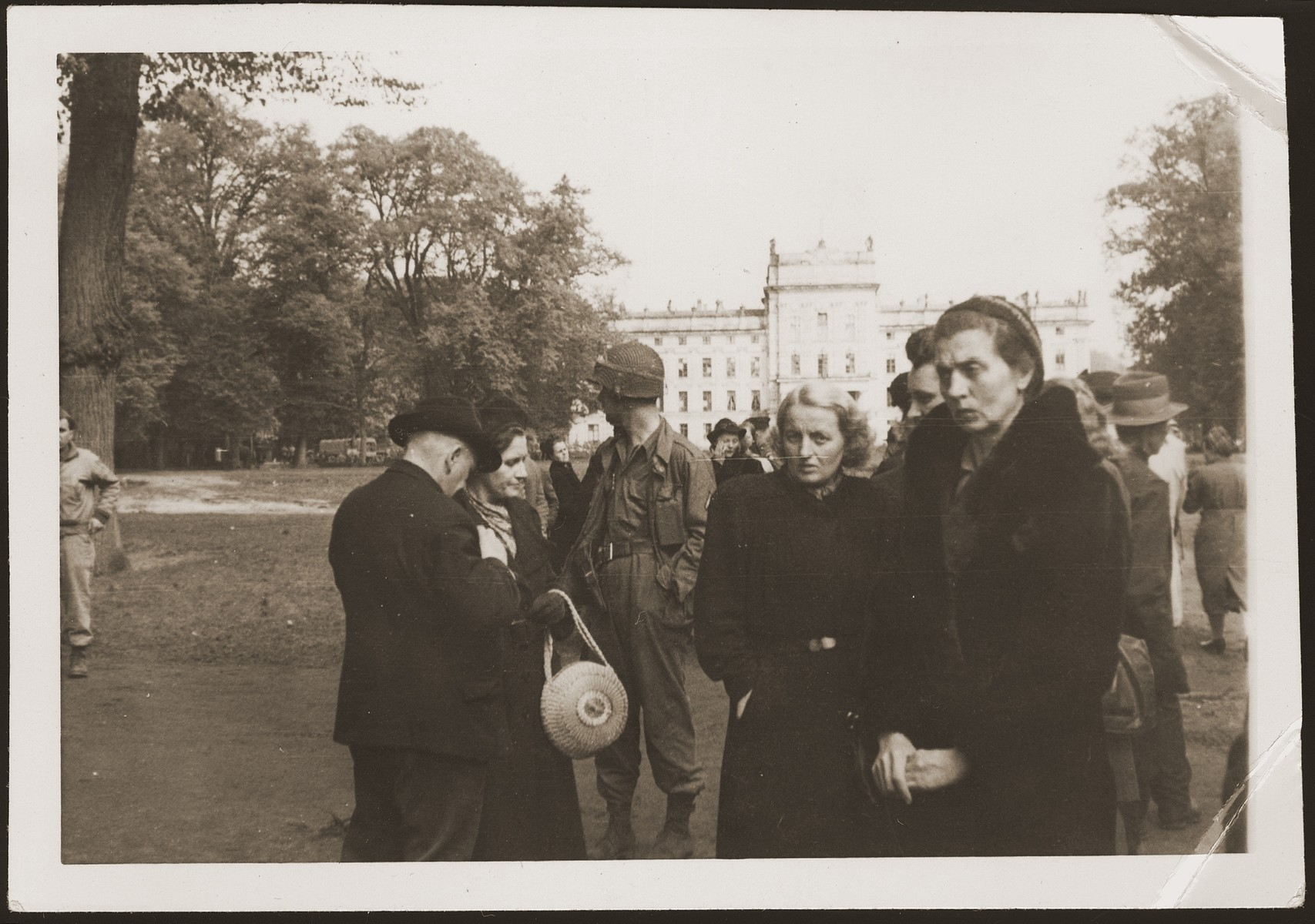 German civilians from Ludwigslust on the palace grounds of the Archduke of Mecklenburg, where they have been forced by U.S. troops to bury the bodies of prisoners killed in the Woebbelin concentration camp.