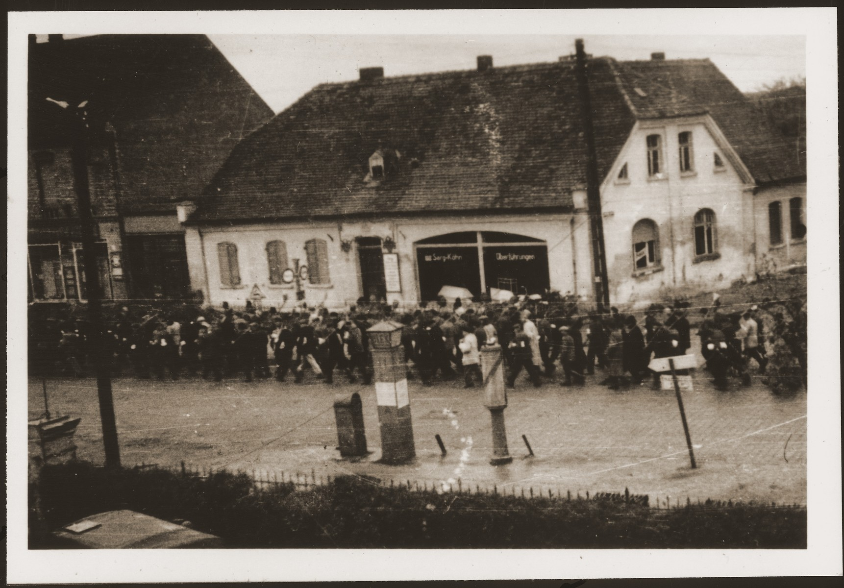 German civilians from Gardelegen march to a barn just outside the town, where they will dig graves for prisoners killed by the SS inside the barn.