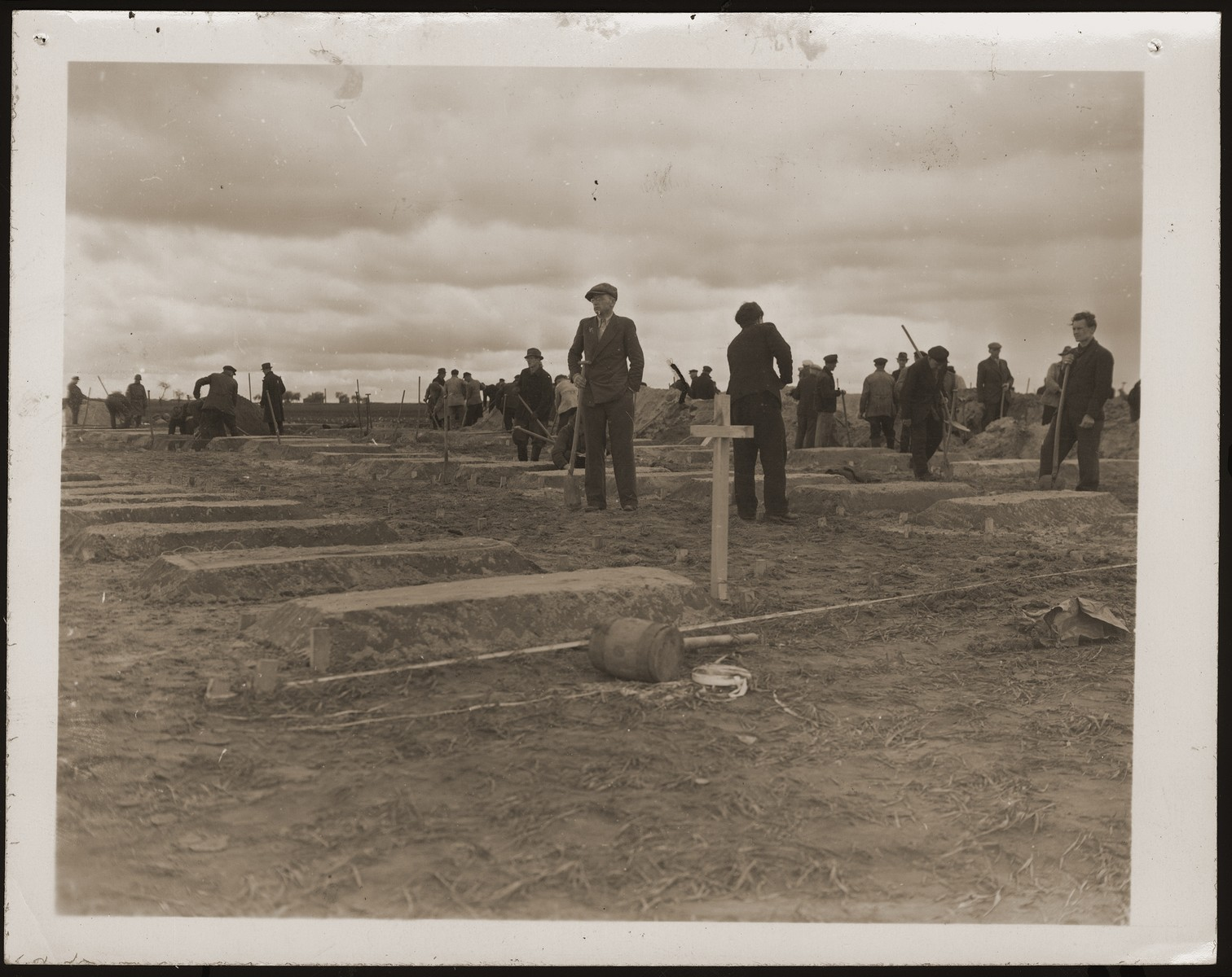German civilians finish graves for concentration camp prisoners killed by the SS in a barn just outside Gardelegen.