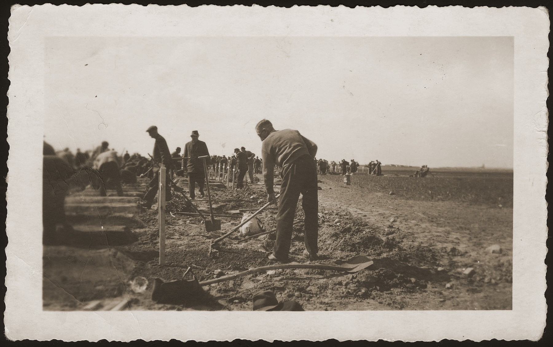German civilians complete graves for the bodies of concentration camp prisoners killed by the SS in a barn just outside of Gardelegen.