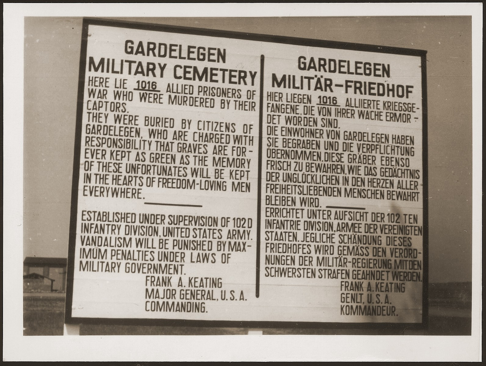 A sign erected at the Military Cemetery in Gardelegen in memory of 1,016 prisoners who were killed by the SS in a barn near the town.