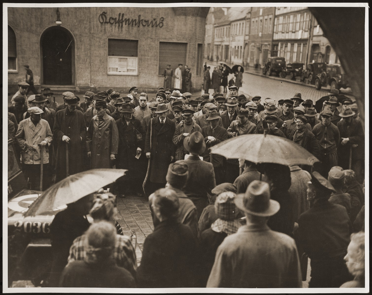 German civilians from Gardelegen gather in the town square where they receive instructions for the burial of the victims of the Gardelegen barn atrocity.