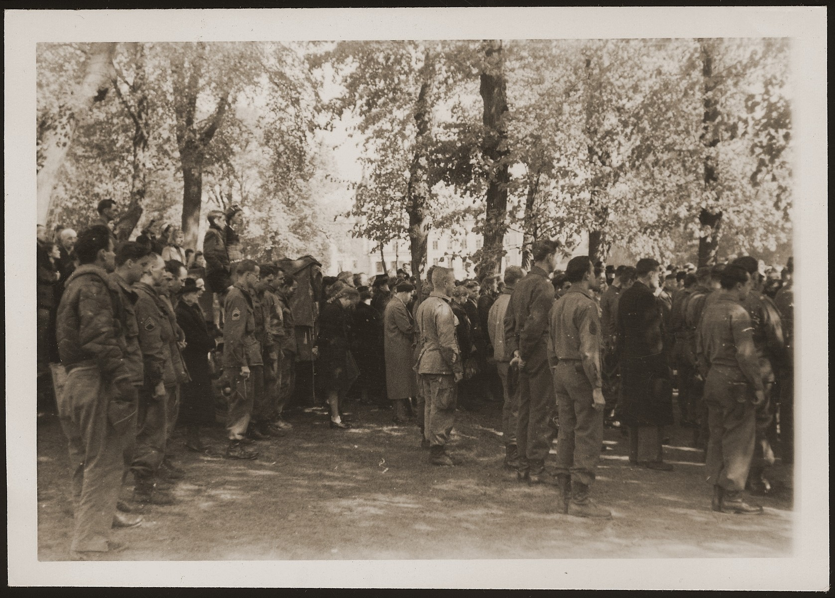 American soldiers at the mass funeral in Ludwigslust on the palace grounds of the Archduke of Mecklenburg, where they forced the townspeople to bury the bodies of prisoners killed in the Woebbelin concentration camp.