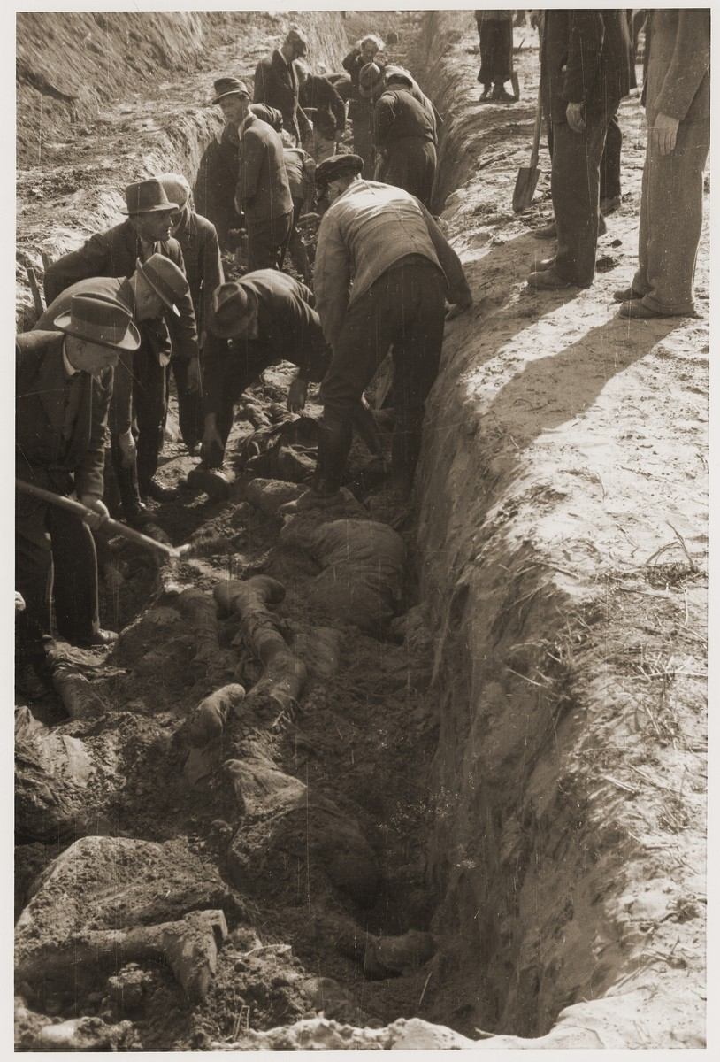 German civilians exhume a mass grave containing the bodies of concentration camp prisoners killed by the SS in a barn just outside of Gardelegen.
