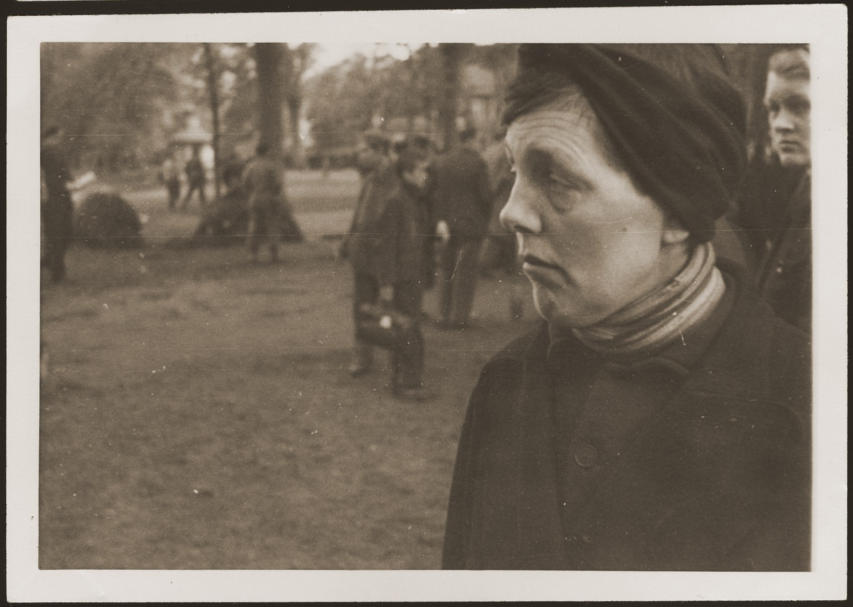 A German woman from Ludwigslust on the palace grounds of the Archduke of Mecklenburg, where they have been forced by U.S. troops to bury the bodies of prisoners killed in the Woebbelin concentration camp.