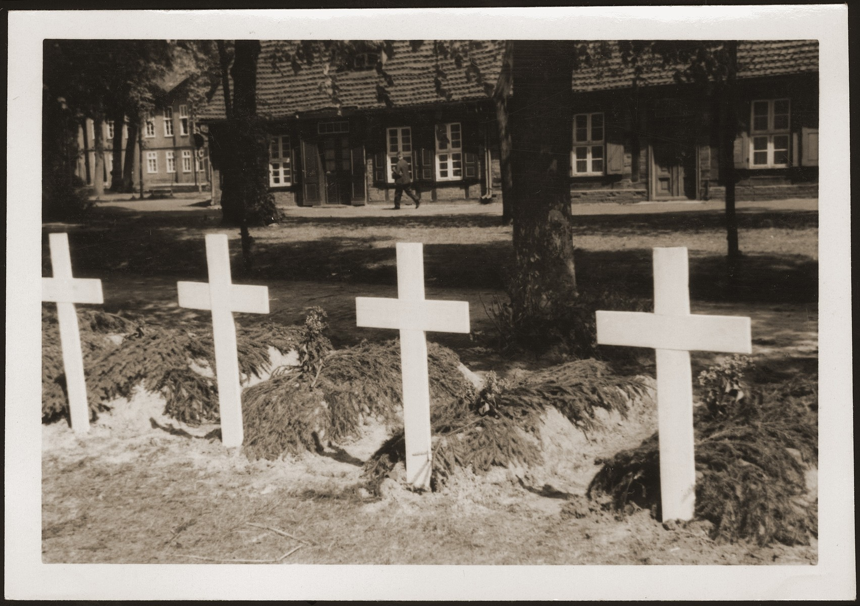 Graves dug by the people of Ludwigslust on the palace grounds of the Archduke of Mecklenburg, where they have been forced by U.S. troops to bury the bodies of prisoners killed in the Woebbelin concentration camp.