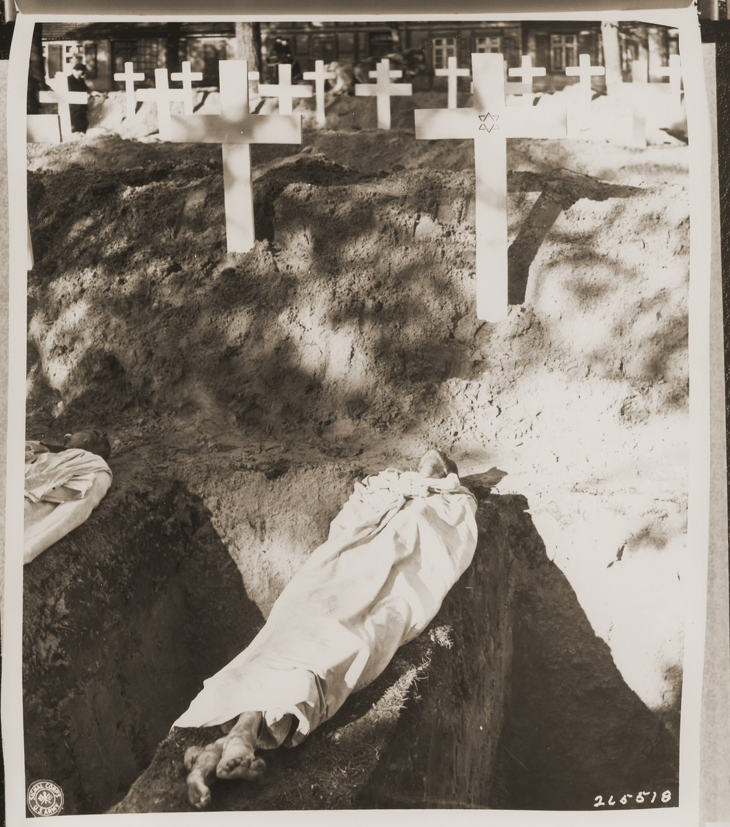 The corpse of a prisoner who died in the concentration camp at Woebbelin lies next to an open grave.    The star of David indicates that this was a Jewish prisoner.  The townspeople were forced by U.S. troops to bury the corpses on the palace grounds of the Archduke of Mecklenburg.