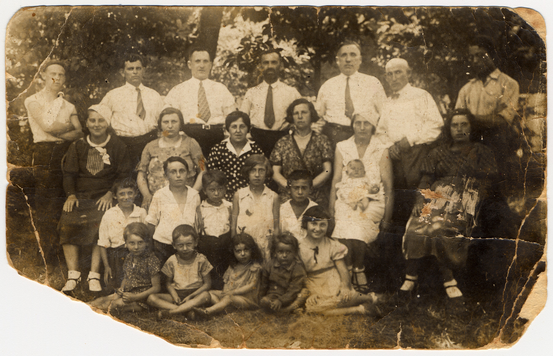 Group portrait of an extended Jewish family in Poland in the 1930s of whom only six survived.  Pictured are the family of Sucher Ceder.  Top row (left to right) are Motel Ceder, Yosel, Yacubowicz, Shloime Ceder, Zukin, Sucher Ceder (donor's father) and Mendel Ceder.  Second row from the top: Malca, Yacubowicz's wife, Chana Ceder, Brandle Rosen (nee Ceder), Mania Ceder (donor's mother) with the donor Irena on her lap, and Dobcia.  Third row from the top: three Zukin children, Sara Ceder (donor's sister), Mordechai Ceder.  Front row: Three children of Yosel, Lutek and Bela.