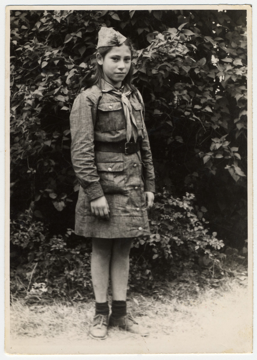 Close-up portrait of a Jewish orphan in a Communist scout uniform in a children's home in Bielsko Biala.  Pictured is the donor, Irena Ceder.