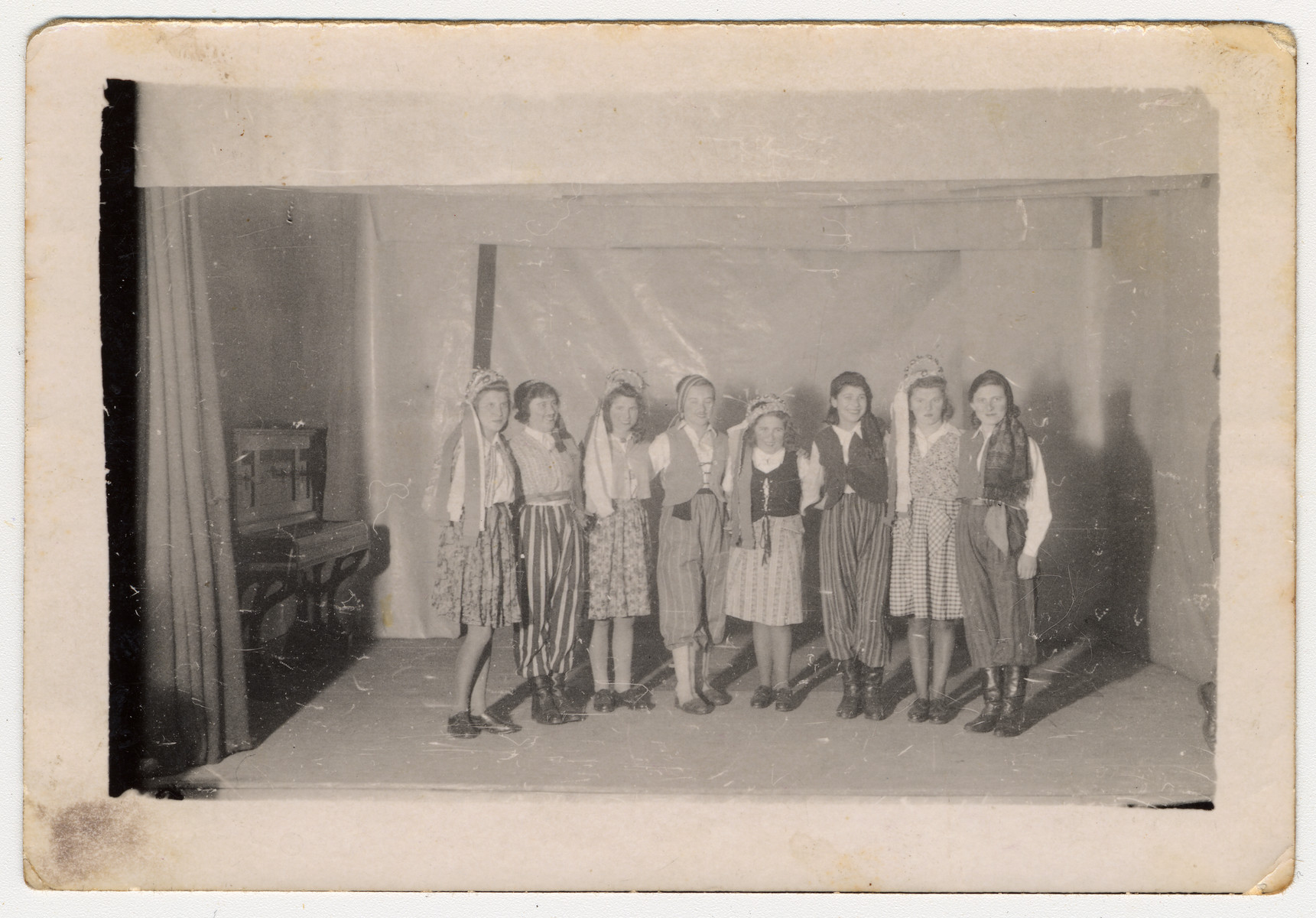 Group portrait of Jewish teenagers in costume during a performance in a children's home in Bielsko Biala.