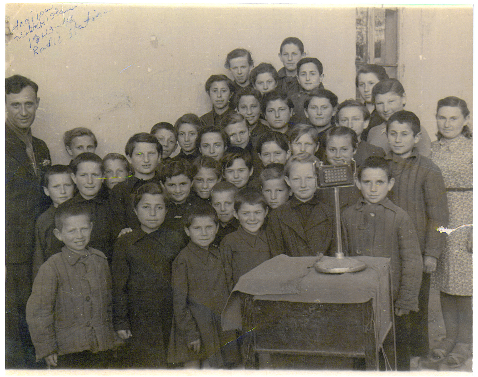 Polish refugee children from an orphanage in Uzbekistan broadcast songs in a radio station in Andizhan.  Among those pictured is Irena Ceder (second row, fourth from the left).