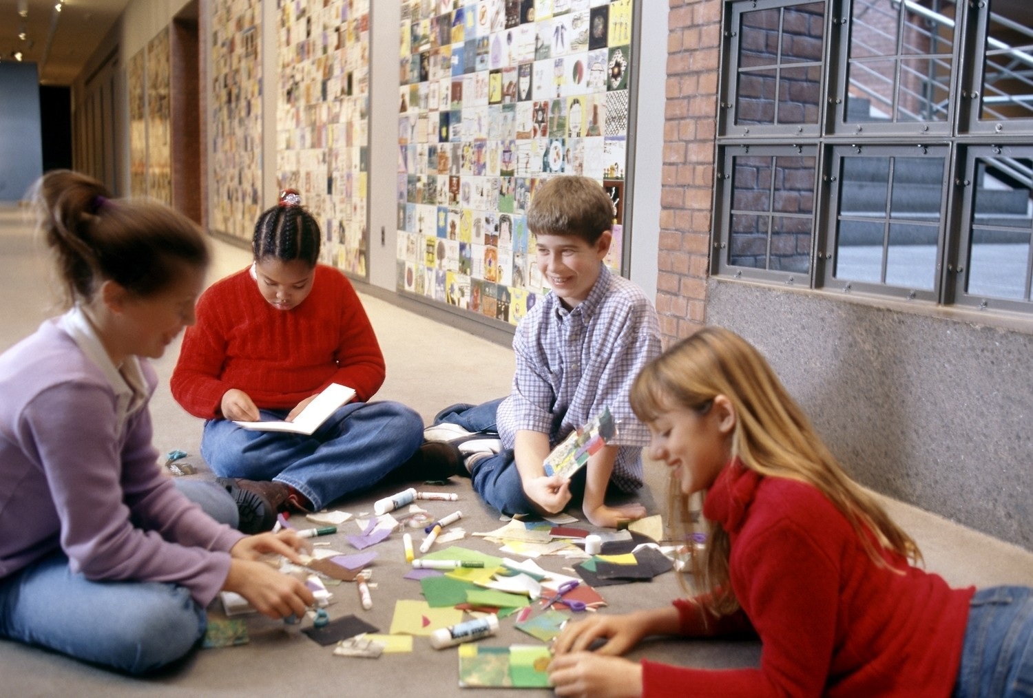 Children take part in an activity at the Tile Wall, U.S. Holocaust Memorial Museum.  The United States Holocaust Memorial Museum offers parents and children ages 9 to 12 family-oriented Sunday programs that creatively introduce the history chronicled in the Museum in a format tailored to a child's sensibilities.