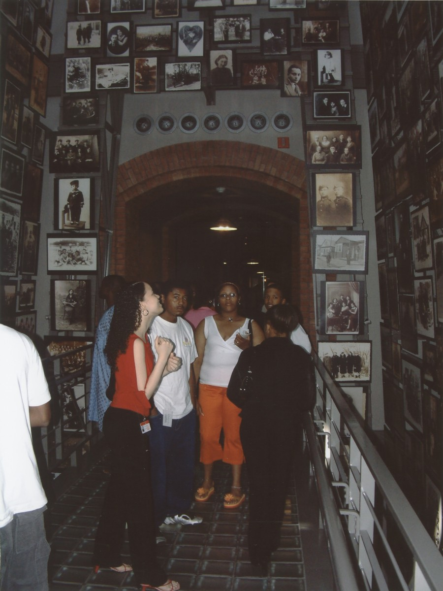 A group of students views the Tower of Faces (Yaffa Eliach Shtetl Collection) in the permanent exhibition of the U.S. Holocaust Memorial Museum.