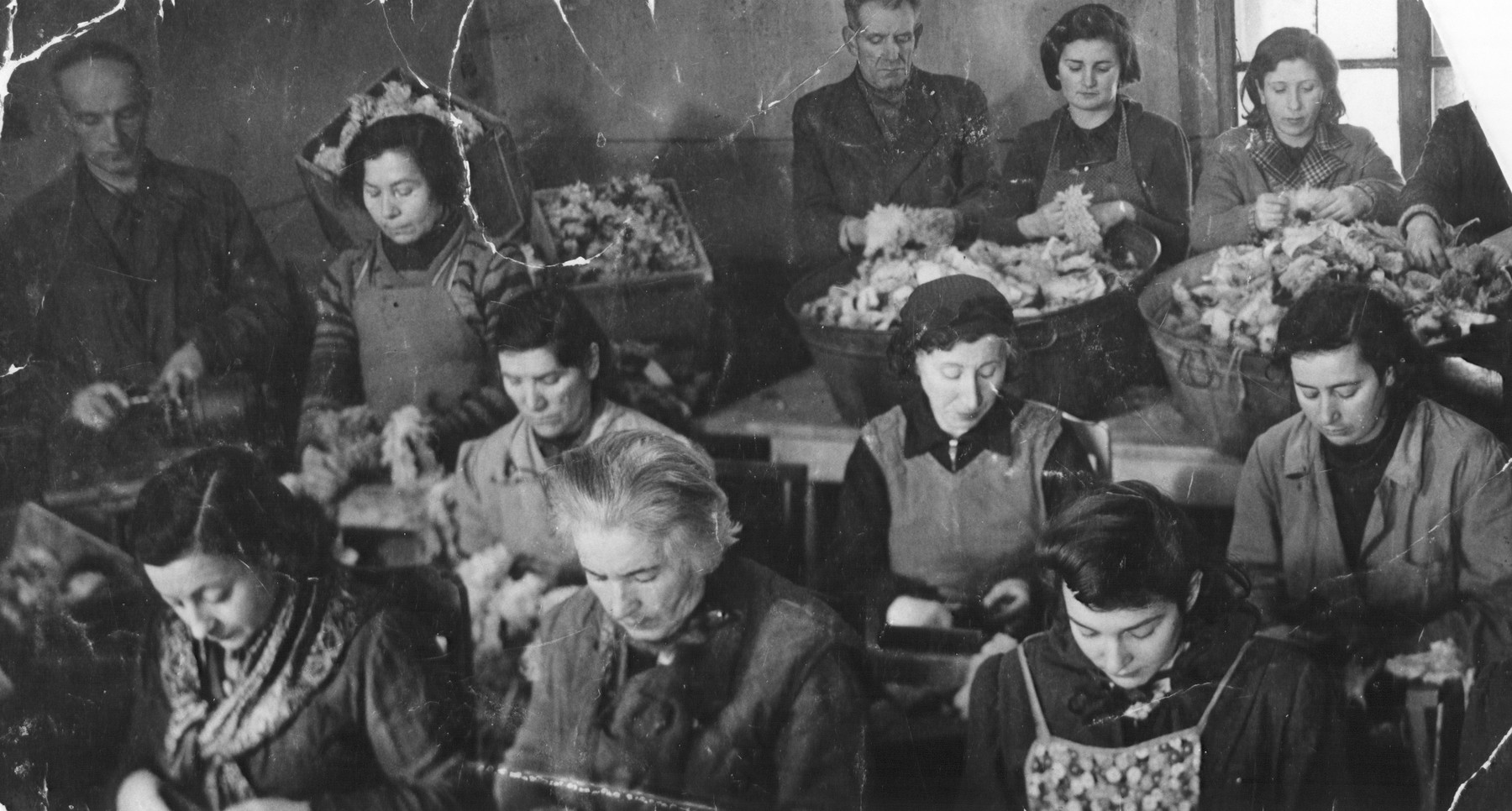 View of women at work in a workshop in the Kovno ghetto.    Among those pictured is Ida Kranowski (bottom right), who perished during the liquidation of the ghetto.