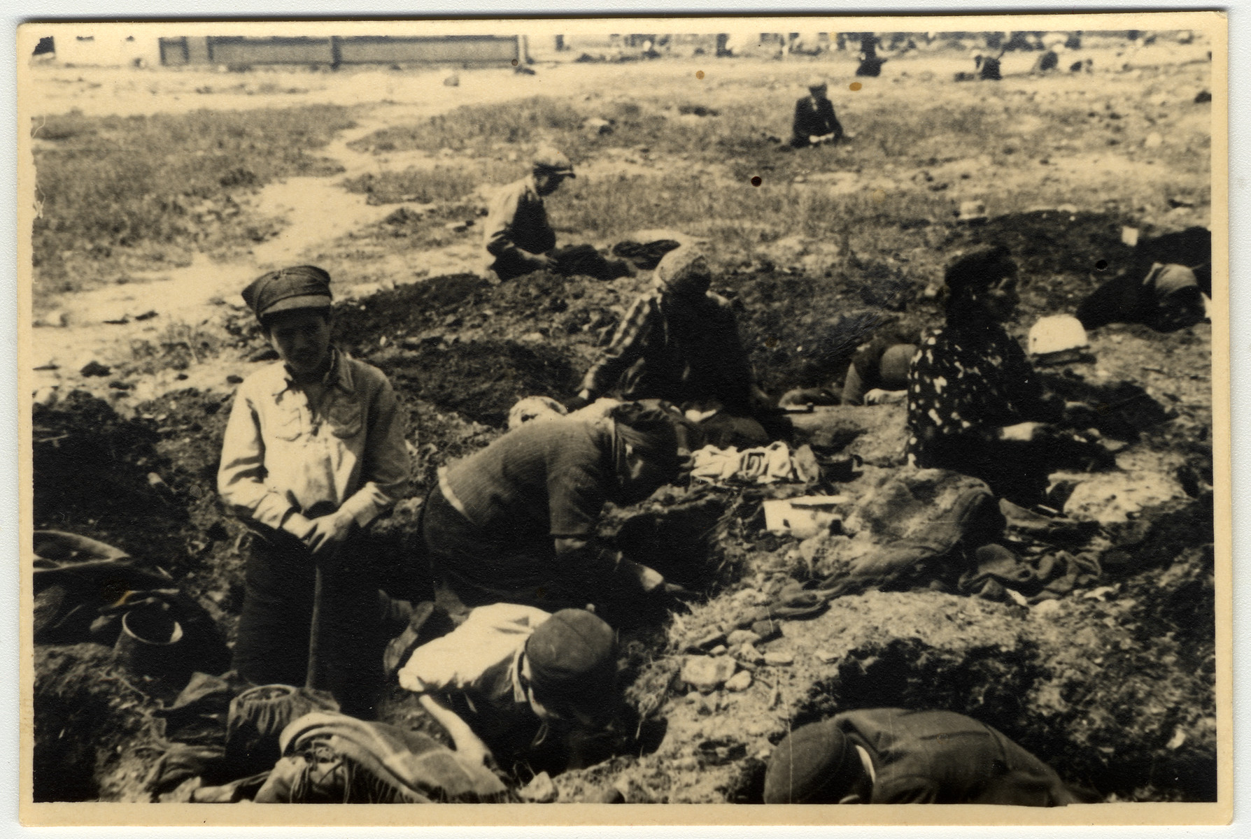 Women and youth in the Lodz ghetto forage for either food or fuel.