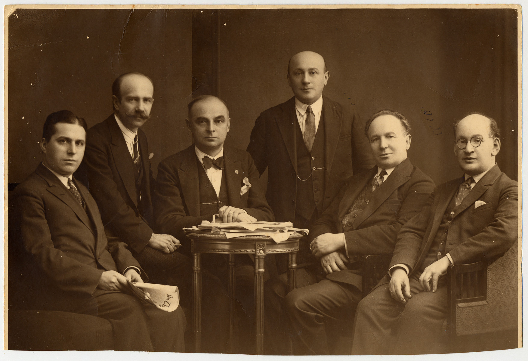 Group portrait of Jewish and Polish musicians.  Pictured are Jakub Surowicz, Kazimierz Butler, Andrzej Bromke, Jozef Labuszynski, Aleksander Junowicz and Pawel Ginsburg.  All (probably) were members of the National (Warsaw) Philharmonic in the 1930s; their instruments Butler: cello; Bromke: trumpet; Labuszynski: bass; Junowicz: flute; Ginsburg: viola.