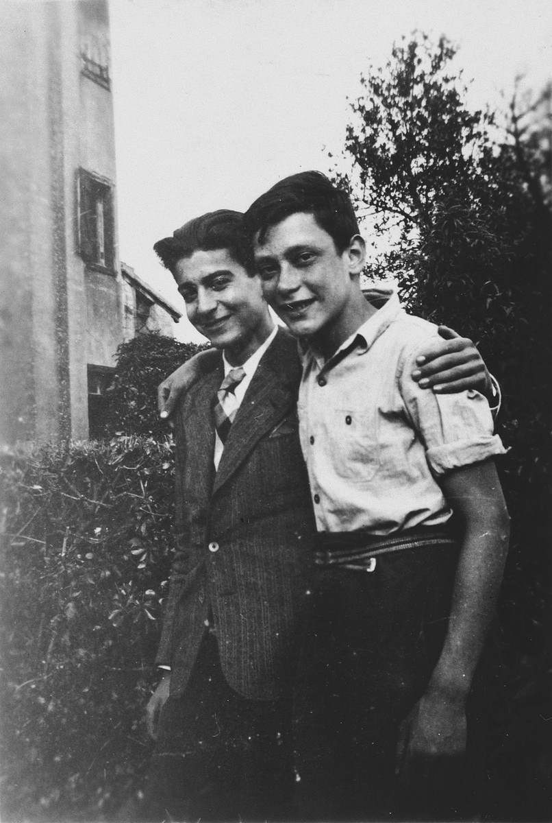 Werner Rindsberg and his friend, Walter Strauss, pose together outside the children's home in Seyre.  Walter Strauss was later captured and deported to Auschwitz where he perished.