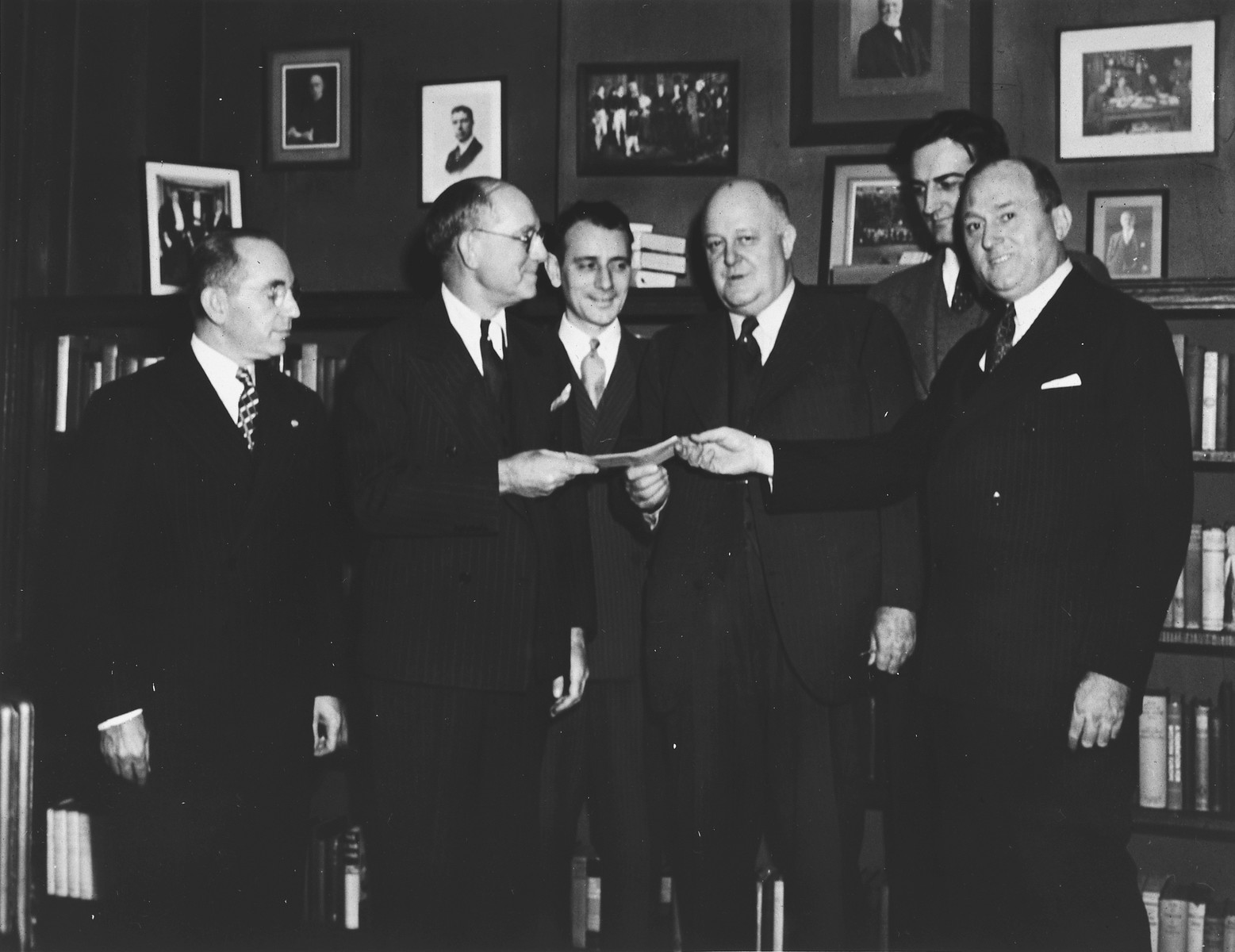 The Bnai Brith Lodge #1 presents a check of $1500 to the British War Relief Society through the Interfaith Committee for Aid to the Democracies.  From left to right are Rabbi William Franklin Rosenblum, Dr. Harold Korn and Lester J. Waldman, president of the Bnai Brith Lodge #1, Dr. Henry Atkinson, General Secretary of the Interfaith Committee, Richard Fagley, Educational Secretary Church Peace Union, Frederick W. Gehle, Chairman Fundraising Division of the British War Relief Society.