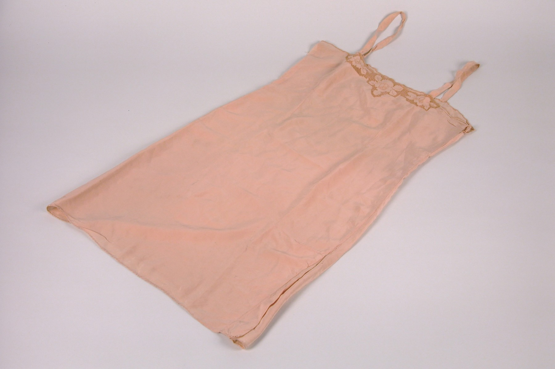 A chemise belonging to Anna Ilona Gondos, that was taken with her when she left Budapest on the Kasztner rescue train.    The chemise was part of her trousseau when she married Bela Gondos in 1934.  Anna packed it along with several others on the Kasztner train to Bergen-Belsen.  It later accompanied her to Switzerland and, ultimately, to the U.S.