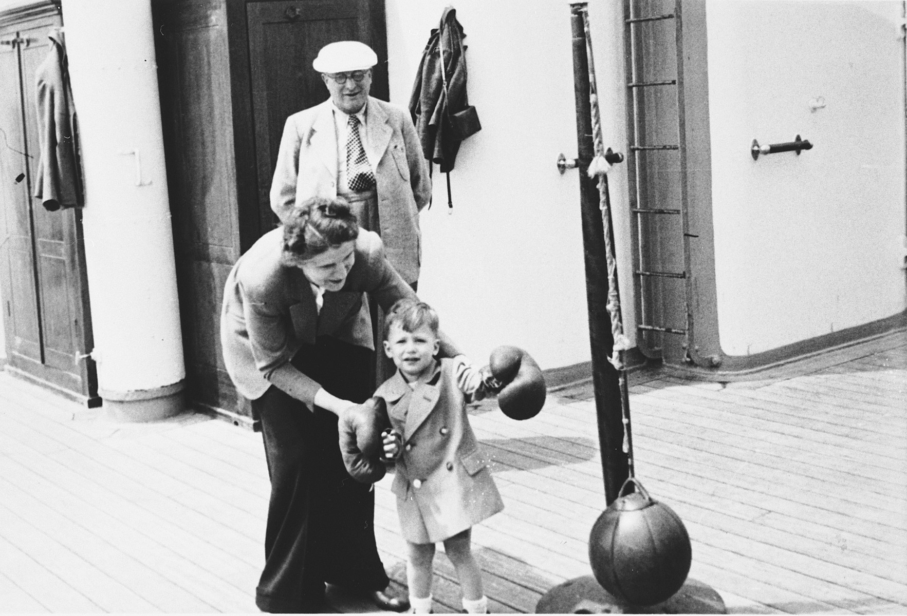 Klara Chraplewski helps her young son play tether ball on board the St. Louis.