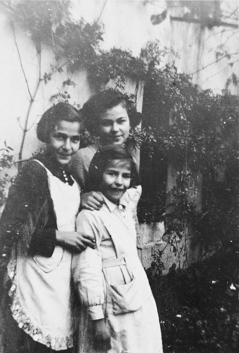 Three sisters pose outside the children's home in Zuen.  Pictured are Regina, Else and Toni Rosenblatt.