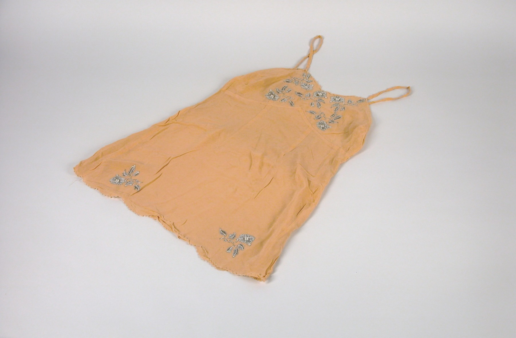 An embrodiered silk chemise belonging to Anna Ilona Gondos, that was taken with her when she left Budapest on the Kasztner rescue train.    The chemise was part of her trousseau when she married Bela Gondos in 1934.  Anna packed it along with several others on the Kasztner train to Bergen-Belsen.  It later accompanied her to Switzerland and, ultimately, to the U.S.