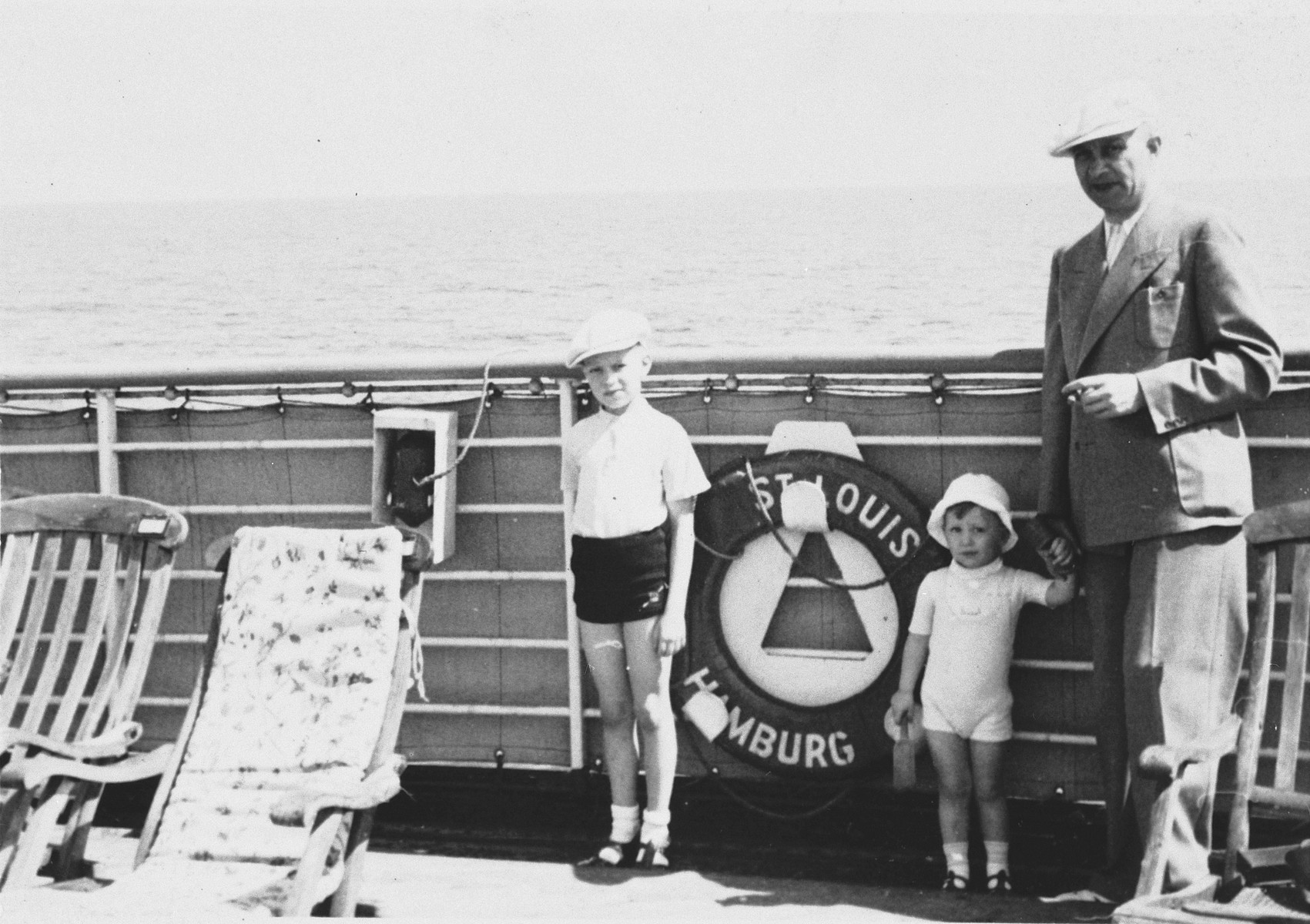Siegfried Chraplewski poses with his two sons on the deck of the St. Louis.