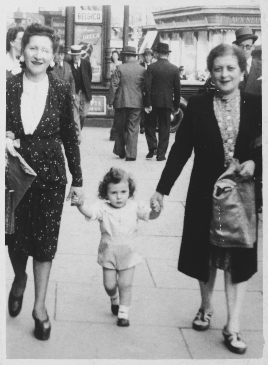 Lea Abramowicz and her sister-in-law Golda Orbach go for a walk with Lea's son, Georges, shortly after liberation.