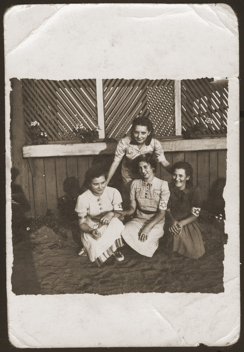 Four girls who are members of the Hanoar Hatzioni Zionist youth movement in the Sosnowiec ghetto.    Pictured in the front row, left to right are: Edzia Cudzynowski; Hadasa Cudzynowski, and Hinda Chilewicz.  Behind them is Rutka Landau, the group leader.