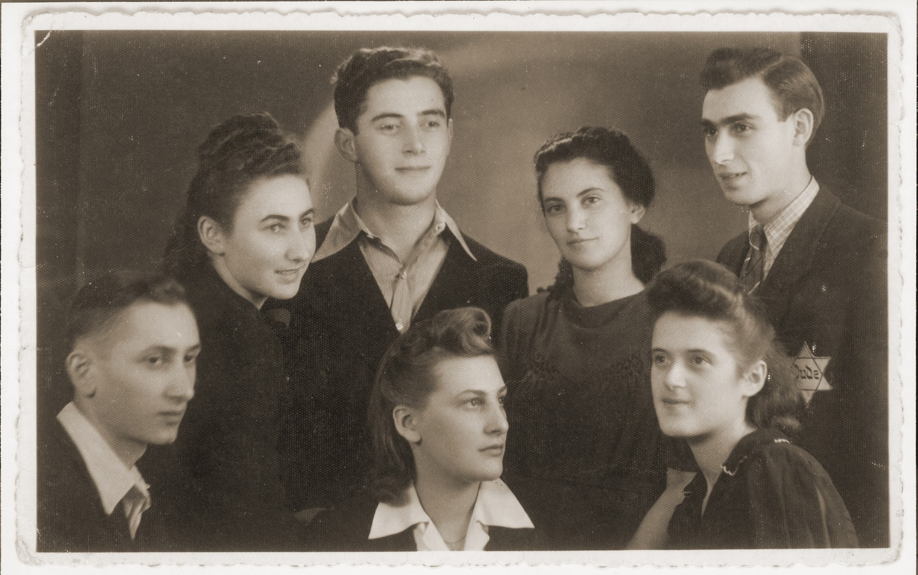 Group portrait of Jewish youth in the Bedzin ghetto.  Among those pictured is Mania Baum (front row, second from the left); Dosia Dafner (front row, right); Rozia Sztrochlic (standing in the second row, second from the right); and Moniek Dafner (Mania's fiance, second row, third from the right).  Moniek survived and lives in the U.S.