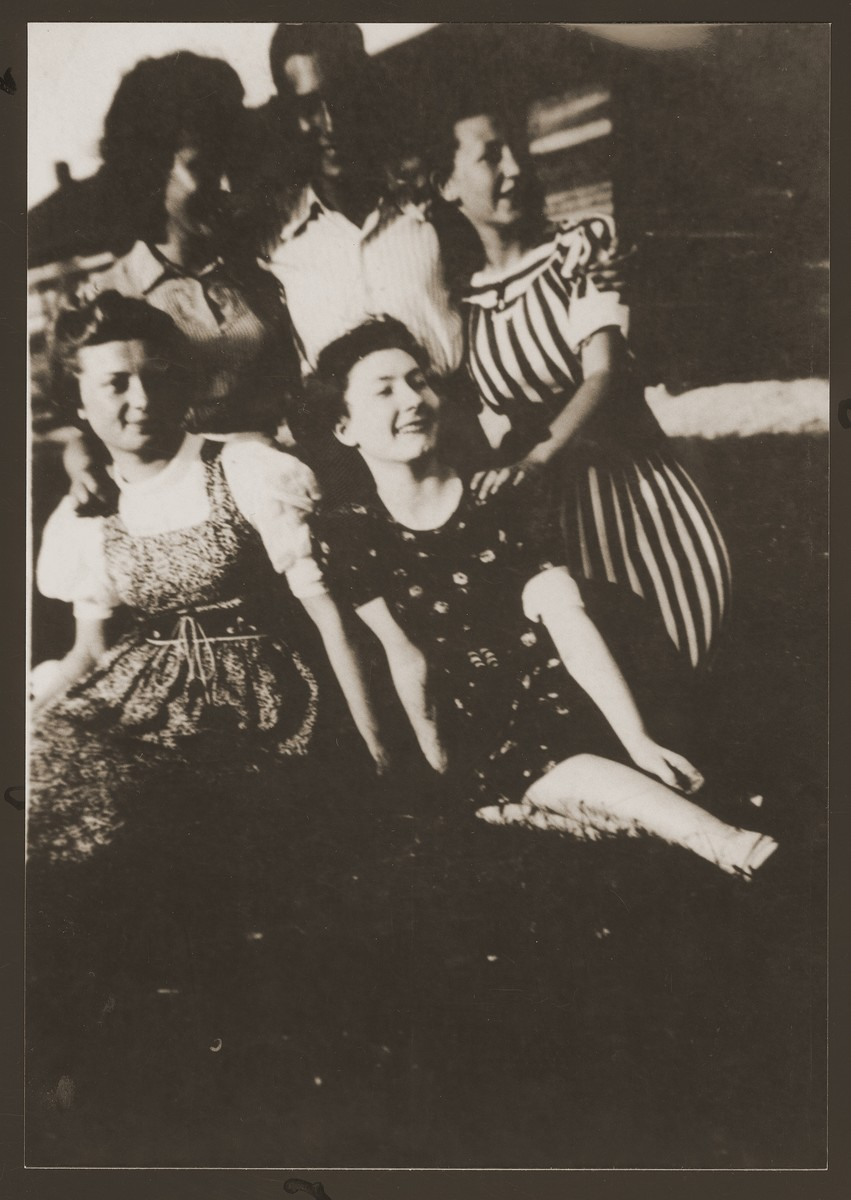 Group portrait of Jewish youth in the Dabrowa ghetto who are members of the Gordonia Zionist youth movement.  Standing from left to right are: Simka Spokojna, Zygmunt Kalmanowicz and Bronka Rubinsztajn.  Seated are Bela Krystal (left) and Shewa Szeps (right, the donor).