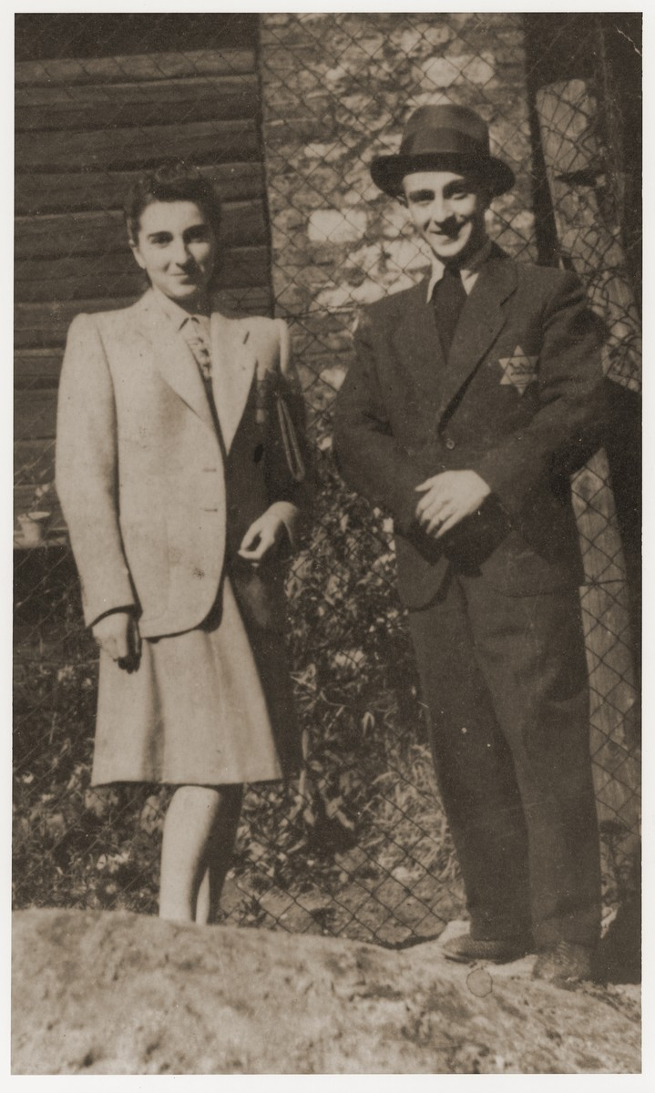 Two Jewish siblings pose in the Dabrowa ghetto wearing the yellow star.  Pictured are Lily Rosenzweig and her brother Siegfried.  Both survived the war.