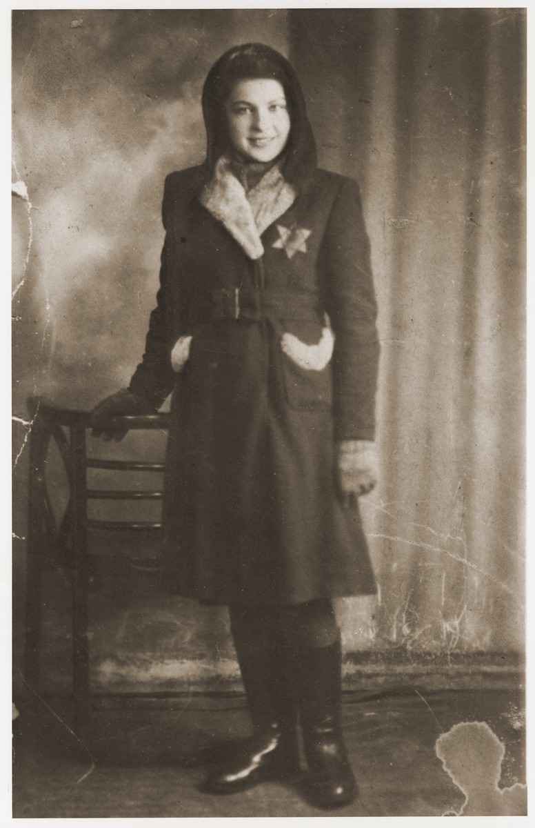 Studio portrait of Rozia Merin wearing a Jewish badge in the Bedzin ghetto.