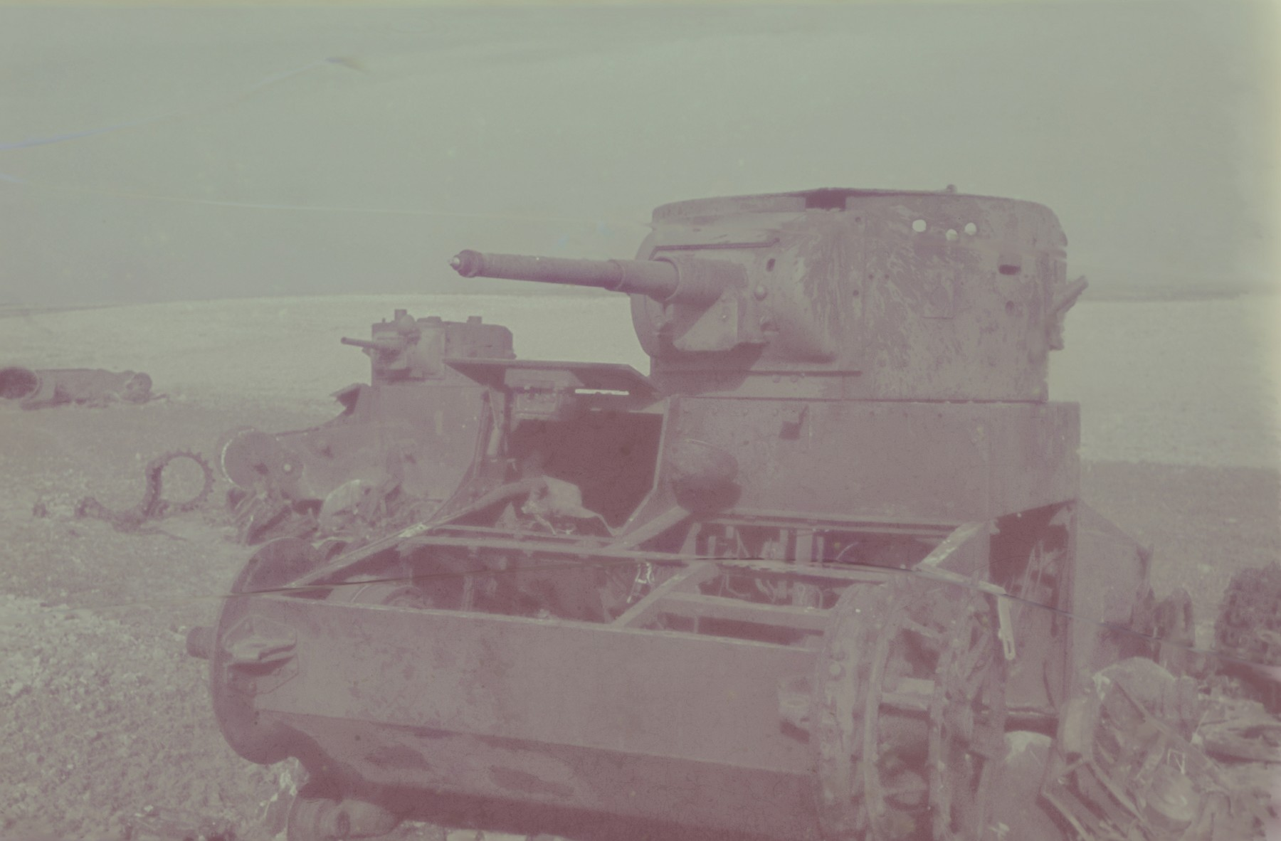 View of an abandoned armored vehicle photographed by Walter Genewein.