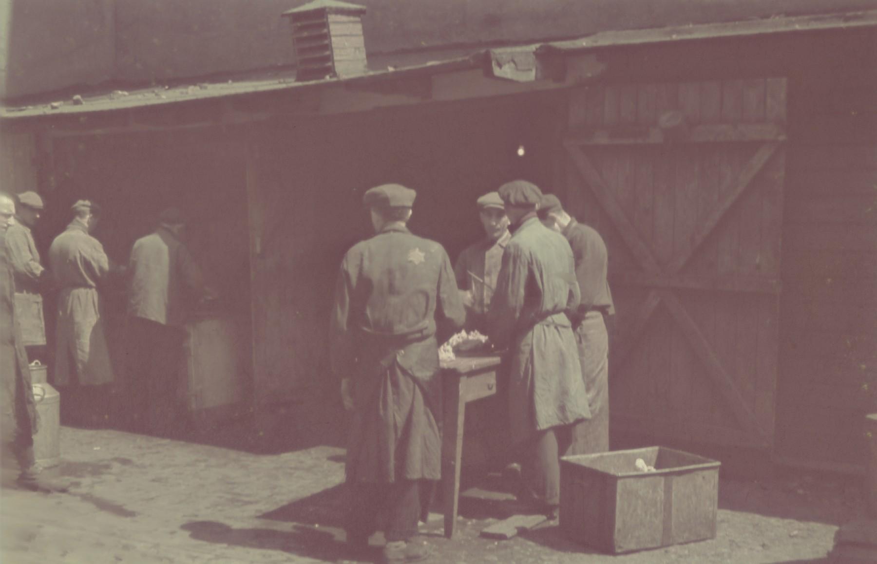 """Jewish men work in the meat distribution center in the Lodz ghetto.  Original German caption: """"Litzmannstadt Getto, Fleischzentrale"""" (meat distribution center), 1942, #181."""