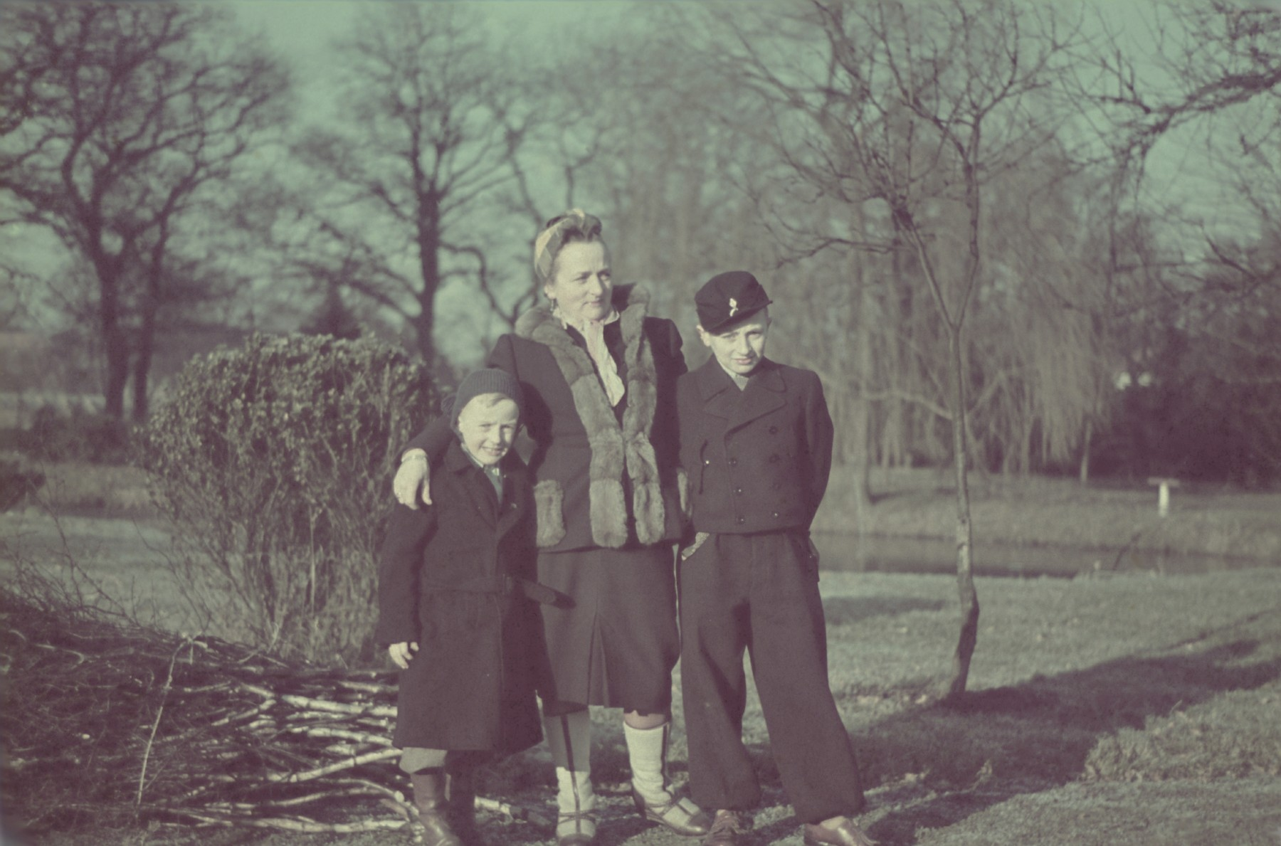 An unidentified woman and two children from the Genewein collection.  (There are several other photographs of these two children in the Genewein collection so they are probably relatives of either Genewein or Hans Biebow).