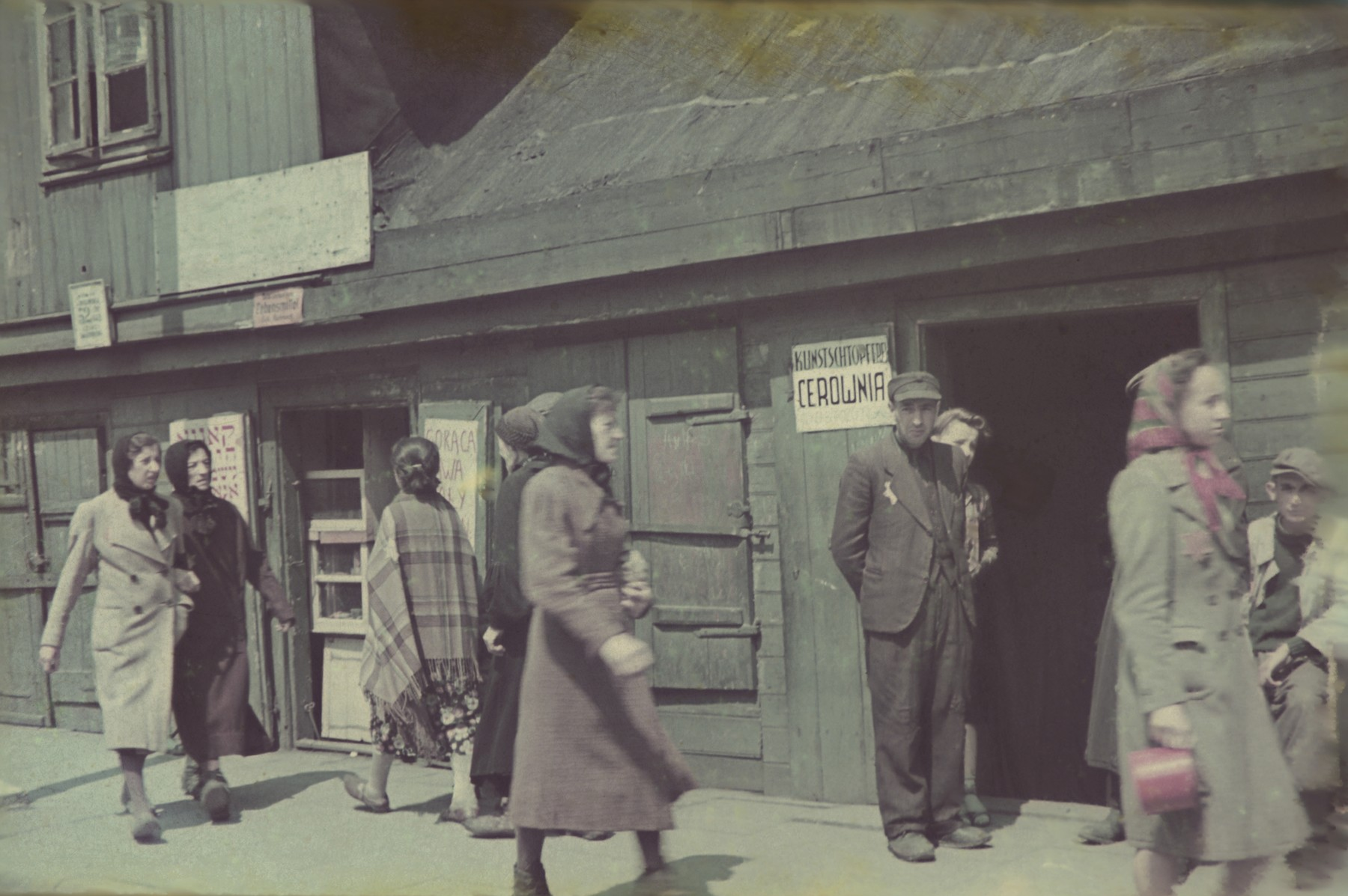 Women walk past a store in the Lodz ghetto.